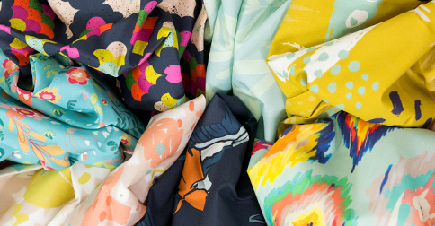 Seven different brightly colored cotton poplin fabrics custom printed by Spoonflower.